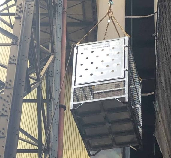 crane lifting cage in use