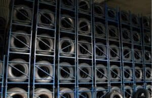 tyres stacked and stored in a foldable steel stillage